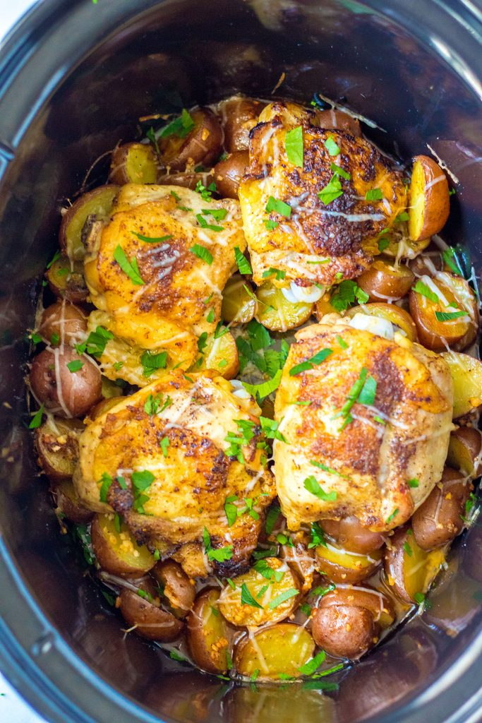 overhead shot of chicken and potatoes in slow cooker