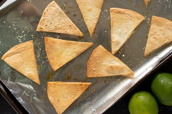 homemade tortilla chips on a baking sheet