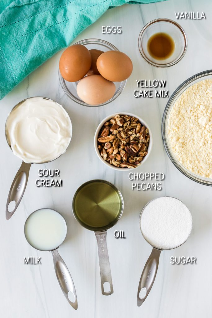 overhead shot of ingredients laid out & labeled to make butter pecan cake