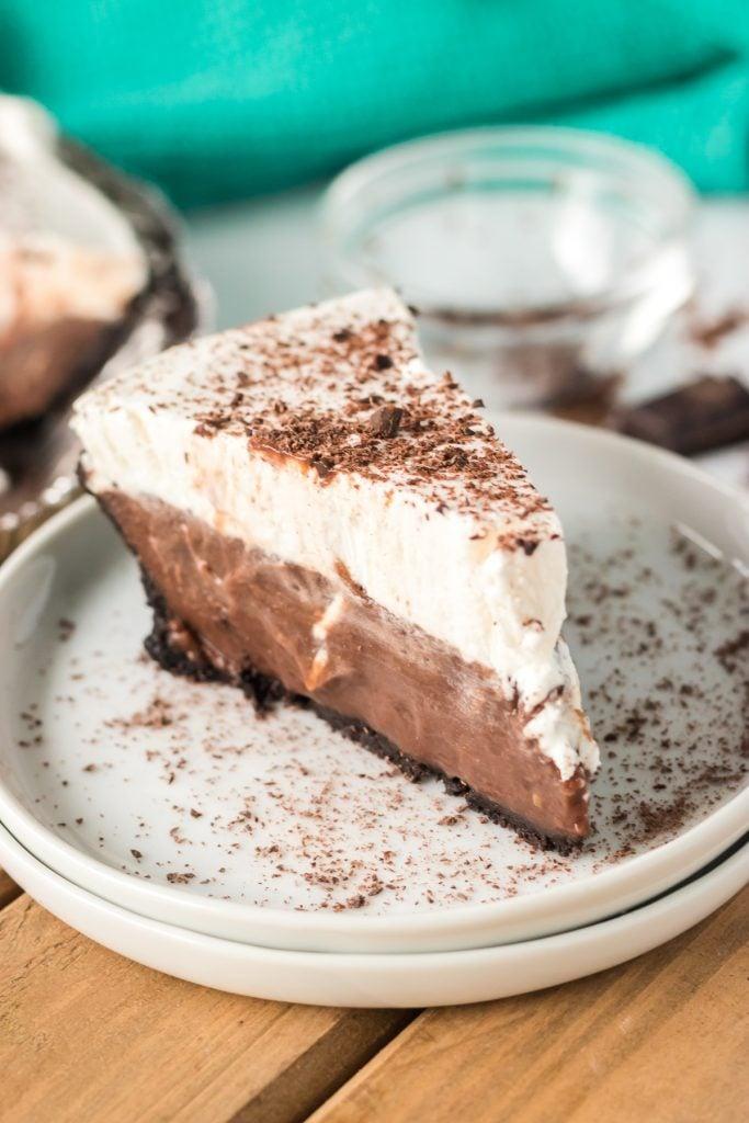 slice of chocolate cream pie on a white plate