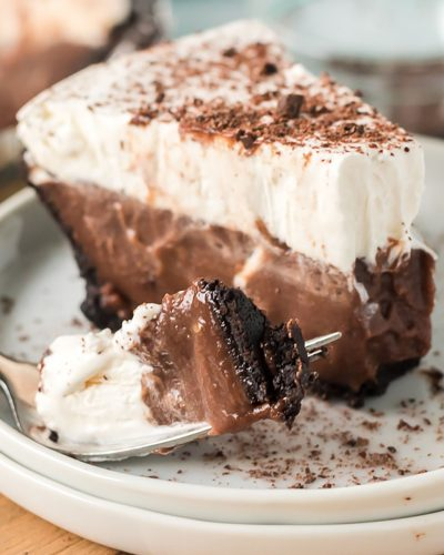 slice of chocolate pudding pie with a bite on a fork next to it