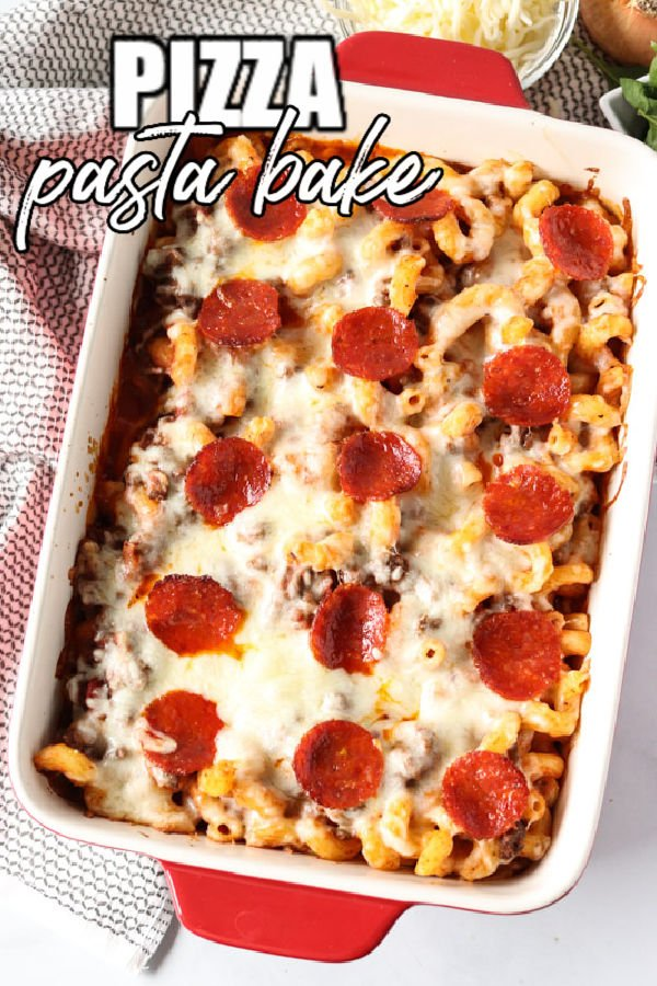 overhead shot of pizza pasta topped with pepperoni in a baking dish