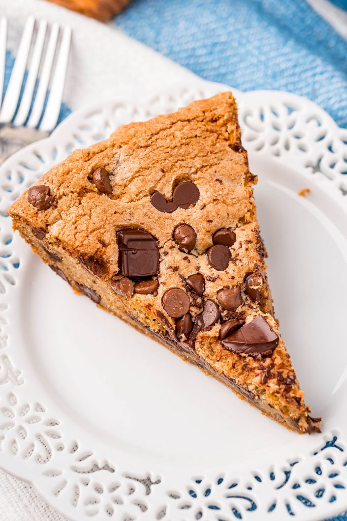 slice of chocolate chip skillet cookie on a white plate