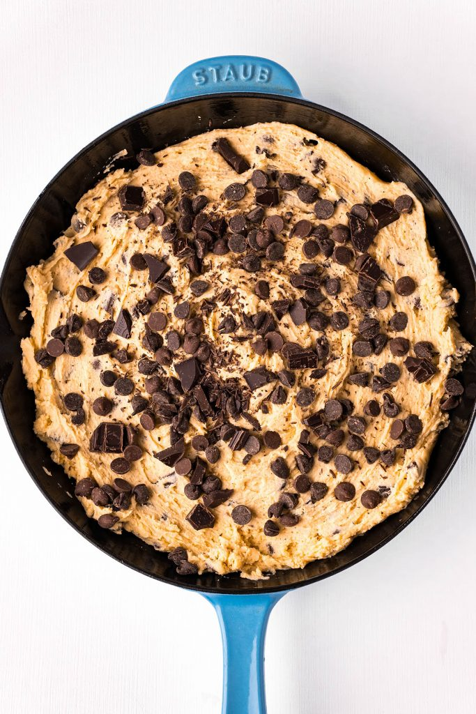 overhead shot of raw cookie dough in a skillet