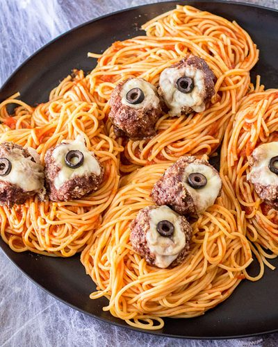 plate of spooky spaghetti and meatballs eyeball pasta