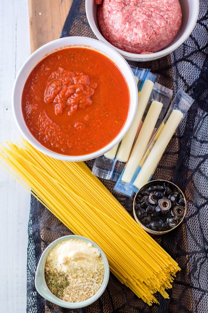 ingredients laid out to make spaghetti and meatballs