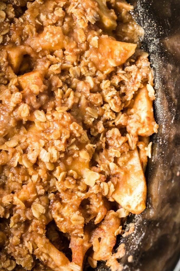 close up shot of apple crisp in a crockpot