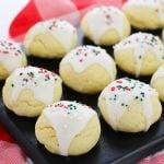 italian sugar cookies with christmas sprinkles on a black platter
