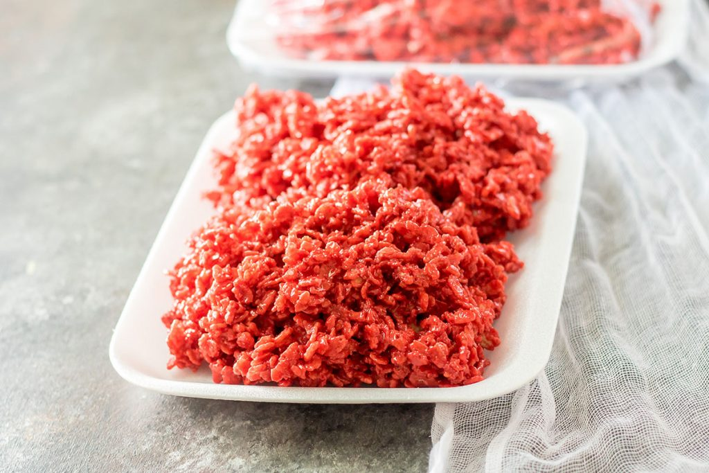 red rice krispies on a white foam tray that looks like raw meat