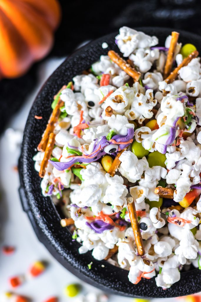 overhead shot of cauldron filled with halloween popcorn mix