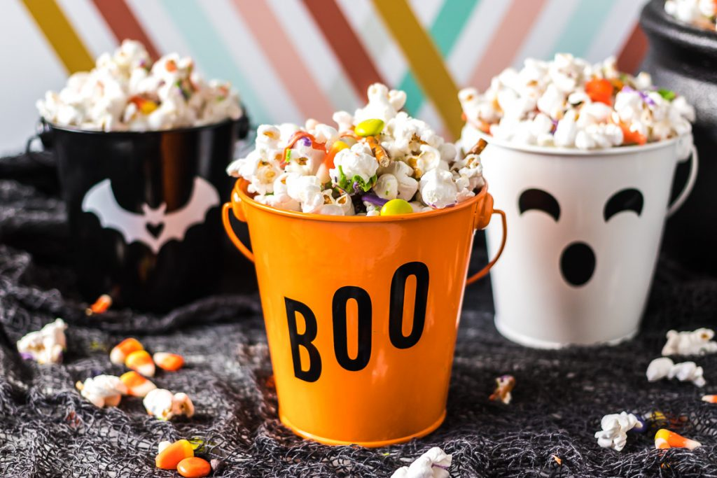 three halloween themed buckets filled with monster munch