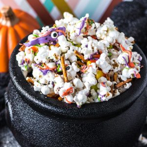 black cauldron filled with monster munch halloween popcorn mix